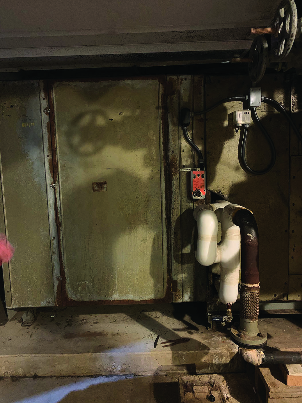 Corrosion and damage in the pool room.