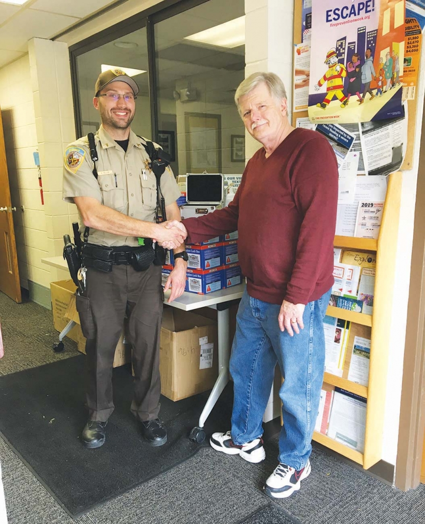 Doug MacLain, right, and Mazomanie Deputy Kyle Keller, left, celebrate a successful drug takeback on Saturday, Nov. 2, at the Mazo Police Department...