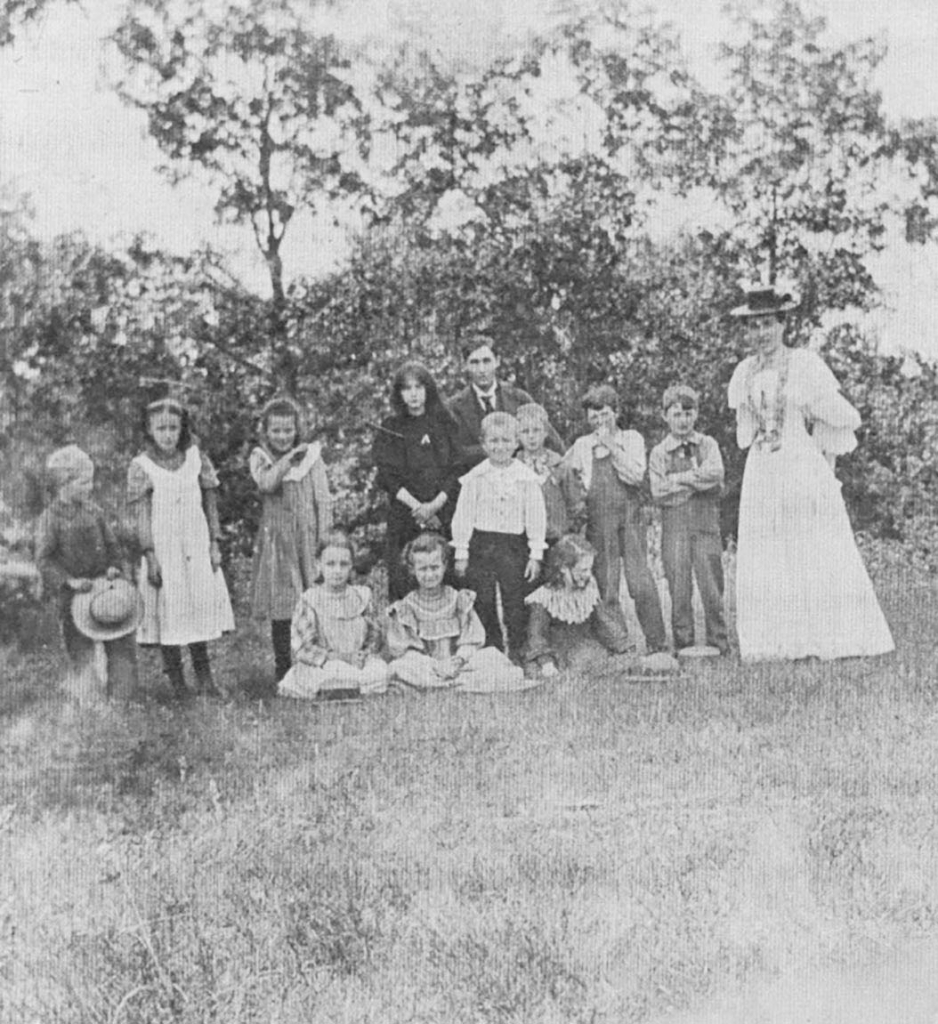 School is back in session! This image courtesy of the Mazomanie Historical Society, shows, Iva (Learnard) Ellis and twelve of her students posing...