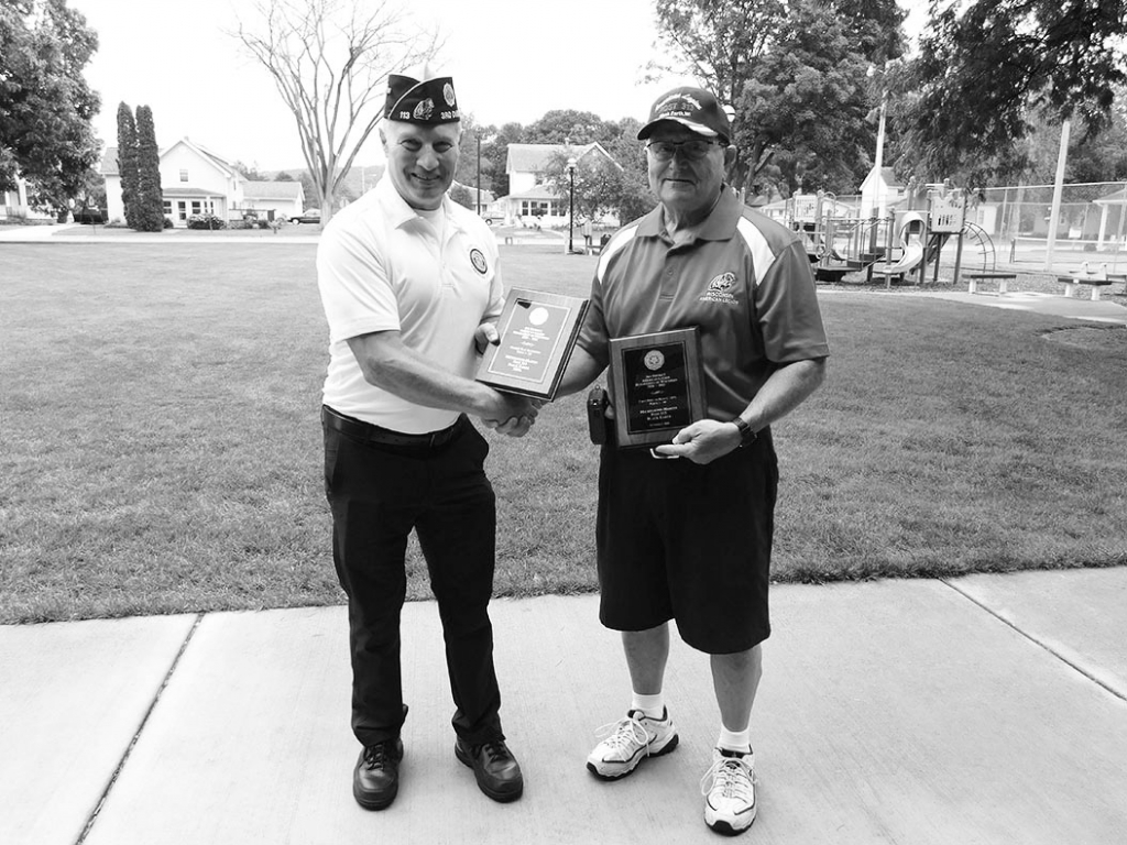 At July's meeting, Commander Dennis J. Wood (right)received two awards, for Black Earth American Legion Post 313 from 3rd District Vice...